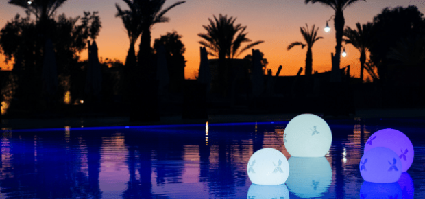 kick off event swimming pool at sunset image
